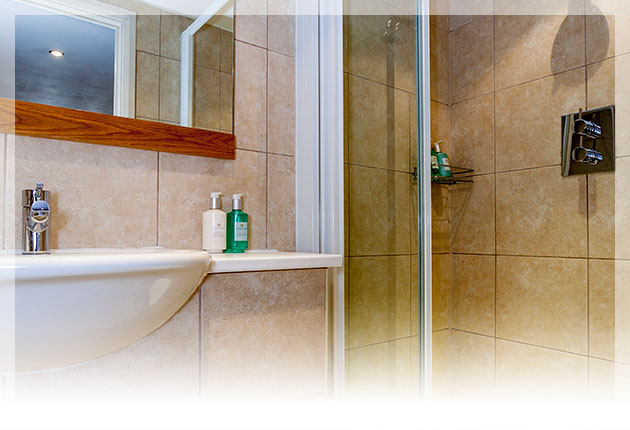 Relax in the modern en-suite with walk in shower